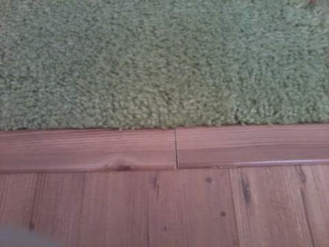 bad seam in laminate floor t-molding